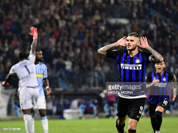 Inter Milan's Argentine forward Mauro Icardi gestures after scoring the second goal team during the Italian Serie A football match Spal vs Inter...