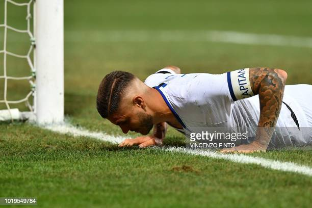 Inter Milan's Argentine forward Mauro Icardi gets back up after falling during the Italian Serie A football match Sassuolo vs Inter Milan at the...