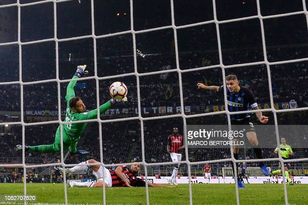 Inter Milan's Argentine forward Mauro Icardi heads the ball to score the winning goal past AC Milan's Italian goalkeeper Gianluigi Donnarumma during...