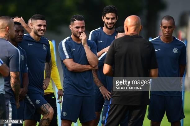 Inter Milan's Argentine forward Mauro Icardi Inter Milan's Italian defender Danilo D'Ambrosio and Inter Milan's Brazilian defender Miranda listen to...