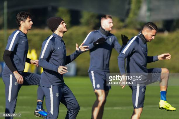 Inter Milan's Argentine forward Mauro Icardi Inter Milan's Italian defender Danilo D'Ambrosio and teammates stretch during a training session at the...