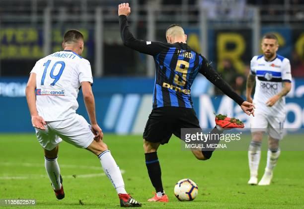 Inter Milan's Argentine forward Mauro Icardi kicks the ball during the Italian Serie A football match Inter Milan vs Atalanta Bergamo on April 7 2019...