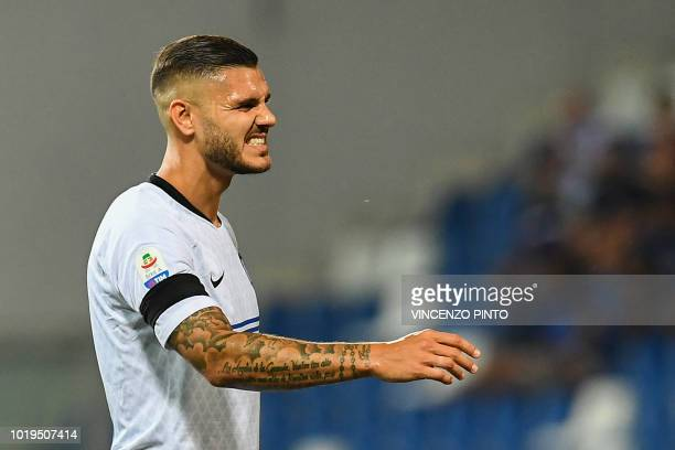 Inter Milan's Argentine forward Mauro Icardi reacts after missing a shot during the Italian Serie A football match Sassuolo vs Inter Milan at the...
