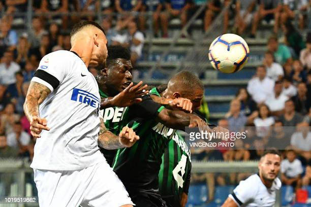Inter Milan's Argentine forward Mauro Icardi, Sassuolo's Ghanaian midfielder Alfred Duncan and Sassuolo's Ghanaian forward Kevin-Prince Boateng go...