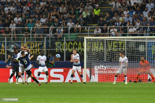 Inter Milan's Argentine forward Mauro Icardi shoots to score an equalizer past Tottenham's Dutch goalkeeper Michel Vorm during the UEFA Champions...