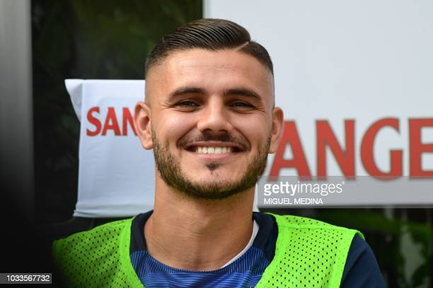 Inter Milan's Argentine forward Mauro Icardi smiles prior to the Italian Serie A football match Inter Milan vs Parma on September 15 2018 at the San...