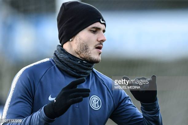 Inter Milan's Argentine forward Mauro Icardi stretches during a training session on the eve of the UEFA Champions League group B football match Inter...