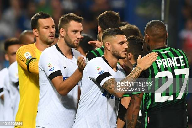 Inter Milan's Argentine forward Mauro Icardi taps on the shoulder of Sassuolo's Ghanaian forward Kevin-Prince Boateng prior to the Italian Serie A...