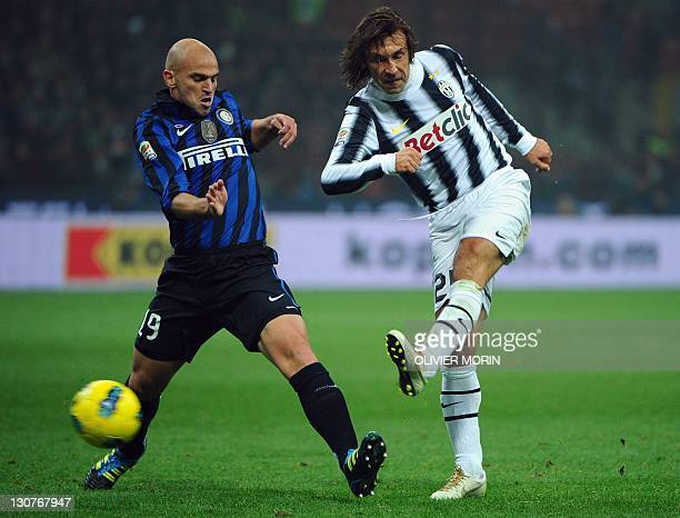 Inter Milan's Argentine midfielder Esteban Matias Cambiasso vies for the ball with Juventus' midfielder Andrea Pirlo during the Italian Serie A...