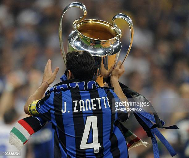 Inter Milan's Argentinian defender and captain Javier Aldemar Zanetti celebrates with the trophy after the UEFA Champions League final football match...