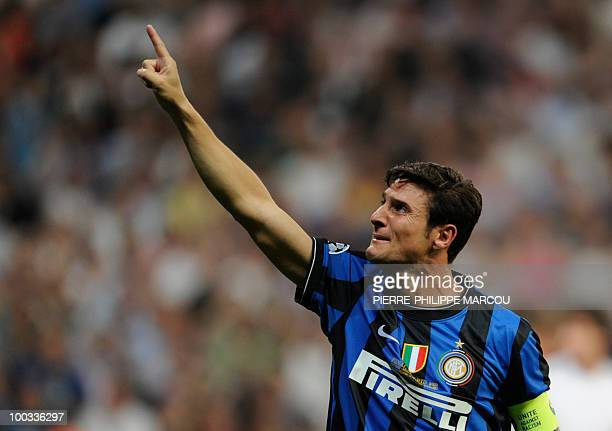 Inter Milan's Argentinian defender and captain Javier Aldemar Zanetti celebrates after the UEFA Champions League final football match Inter Milan...
