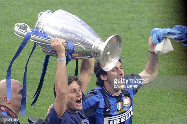 Inter Milan's Argentinian defender and captain Javier Aldemar Zanetti and Inter Milan's Argentinian forward Alberto Milito show the Champions League...