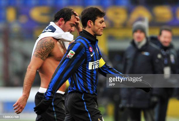 Inter Milan's Argentinian defender Javier Zanetti and Inter Milan's Serbian midfielder Dejan Stankovic leave the pitch at the end of the Italian...