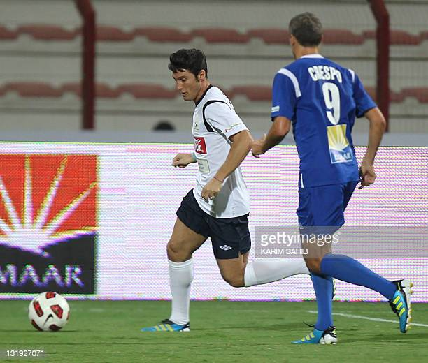 Inter Milan's Argentinian footballer Javier Zanetti competes with Argentina's Hernan Crespo during an allstar international charity football match at...