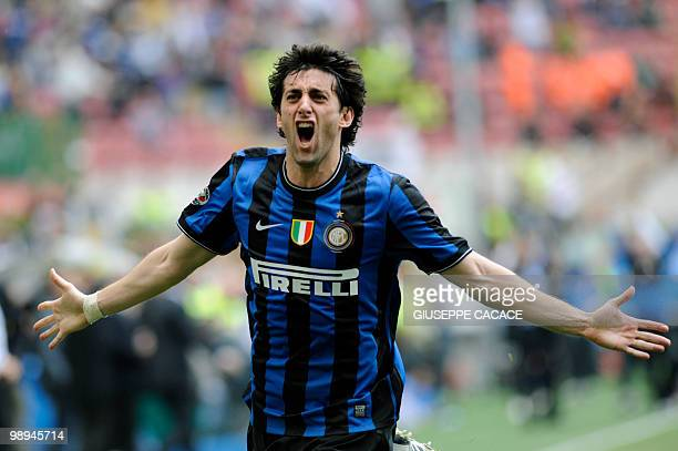 Inter Milan's Argentinian forward Alberto Milito Diego celebrates after scoring against Chievo during their Serie A football match at San Siro...