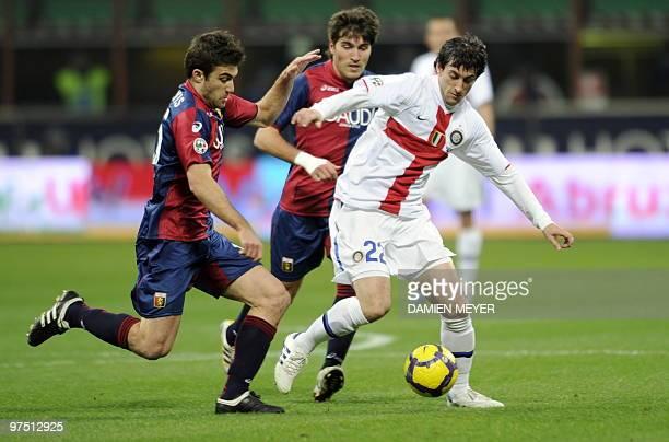 Inter Milan's Argentinian forward Alberto Milito fights for the ball with Genoa's Spanish midfielder Alberto Zapater Arjol and Genoa's Greek defender...