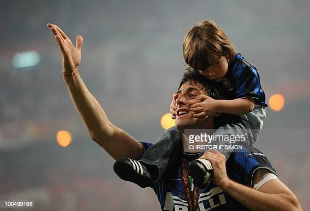 Inter Milan's Argentinian forward Diego Milito celebrates after winning the UEFA Champions League final football match Inter Milan against Bayern...
