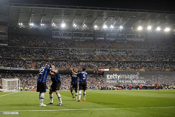 Inter Milan's Argentinian forward Diego Milito celebrates with teammates after scoring his second goal during the UEFA Champions League final...