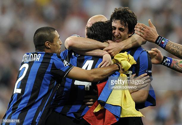 Inter Milan's Argentinian forward Diego Milito celebrates with teammates after winning the UEFA Champions League final football match Inter Milan...