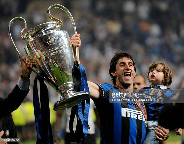 Inter Milan's Argentinian forward Diego Milito celebrates with the trophy after winning the UEFA Champions League final football match Inter Milan...