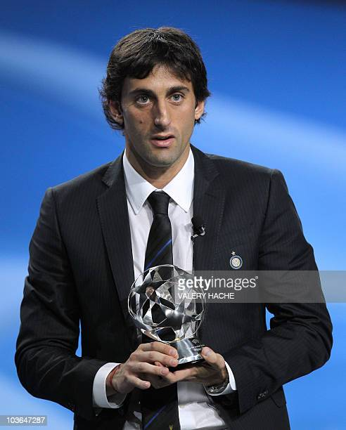 """Inter Milan's Argentinian forward Diego Milito poses with his trophy after being awarded best forward for the year 2010 during """"club forward of the..."""
