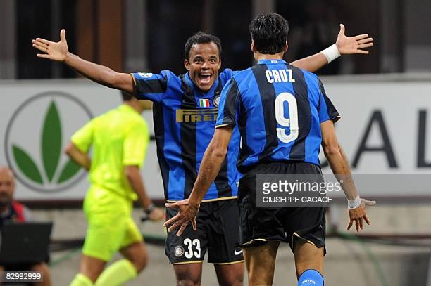 Inter Milan's Argentinian forward Julio Cruz celebrates after scoring a goal with Inter Milan's Brasilian forward Amantino Mancini during their...