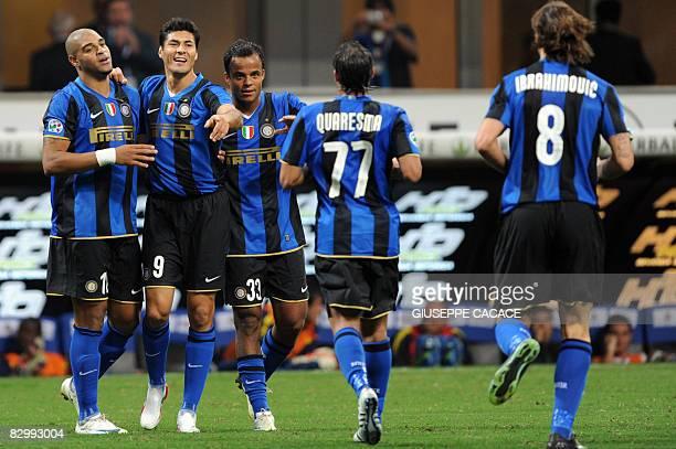 Inter Milan's Argentinian forward Julio Cruz celebrates after scoring a goal with Inter Milan's Brazilian forward Adriano and Inter Milan's Brazilian...