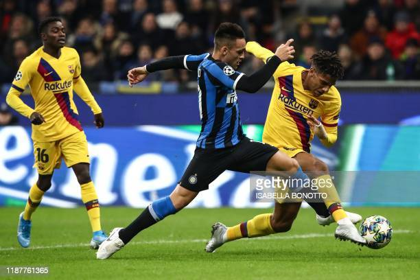 Inter Milan's Argentinian forward Lautaro Martinez and Barcelona's French defender JeanClair Todibo go for the ball during the UEFA Champions League...