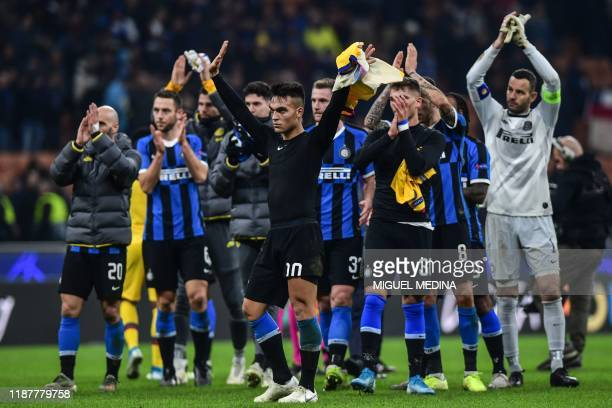 Inter Milan's Argentinian forward Lautaro Martinez and teammates acknowledge the public at the end of the UEFA Champions League Group F football...