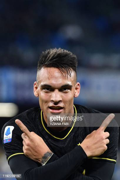 Inter Milan's Argentinian forward Lautaro Martinez celebrates after scoring during the Italian Serie A football match Napoli vs Inter Milan on...