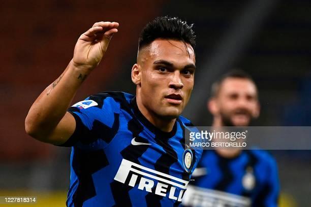 Inter Milan's Argentinian forward Lautaro Martinez celebrates after scoring during the Italian Serie A football match Inter Milan vs Napoli played...