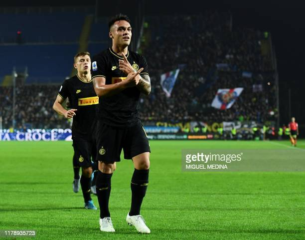 Inter Milan's Argentinian forward Lautaro Martinez celebrates scoring his team's first goal during the Italian Serie A football match Brescia vs...