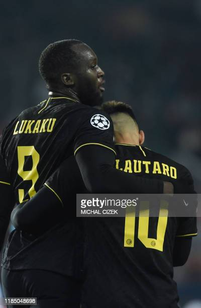 Inter Milan's Argentinian forward Lautaro Martinez celebrates scoring the opening goal with his teammate Belgian forward Romelu Lukaku during the...