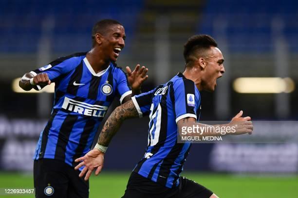 Inter Milan's Argentinian forward Lautaro Martinez celebrates scoring his team's third goal followed by Inter Milan's English midfielder Ashley Young...