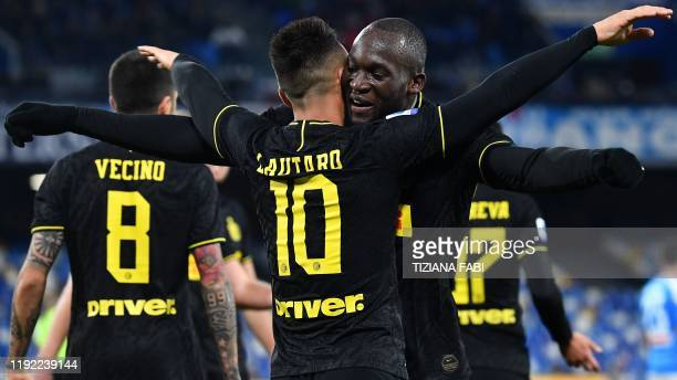 Inter Milan's Argentinian forward Lautaro Martinez celebrates with Inter Milan's Belgian forward Romelu Lukaku after scoring during the Italian Serie...