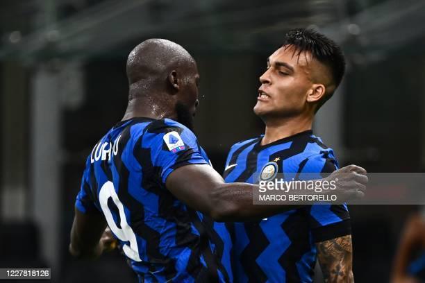 Inter Milan's Argentinian forward Lautaro Martinez celebrates with Inter Milan's Belgian forward Romelu Lukaku after scoring during the Italian Serie...