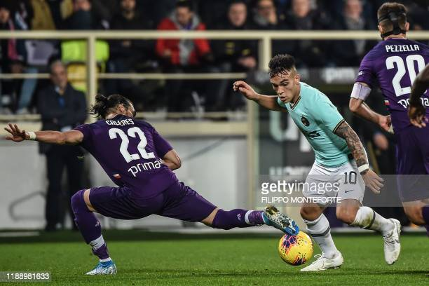 Inter Milan's Argentinian forward Lautaro Martinez challenges Fiorentina's Uruguayan defender Martin Caceres during the Italian Serie A football...