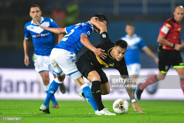 Inter Milan's Argentinian forward Lautaro Martinez fights for the ball with Brescia's Czech midfielder Ales Mateju during the Italian Serie A...