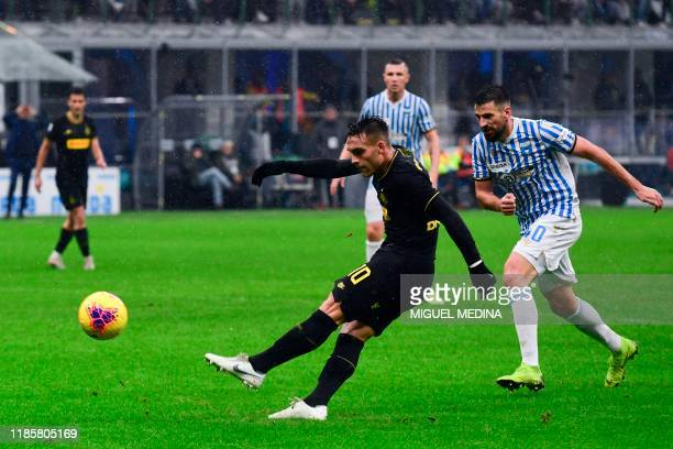 Inter Milan's Argentinian forward Lautaro Martinez kicks the ball during the Italian Serie A football match Inter Milan vs SPAL on December 1 at the...