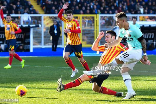 Inter Milan's Argentinian forward Lautaro Martinez shoots on goal despite Lecce's Italian defender Fabio Lucioni during the Italian Serie A football...