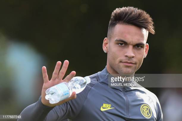 Inter Milan's Argentinian forward Lautaro Martinez waves during a training session on October 22, 2019 in Appiano Gentile, on the eve of the UEFA...
