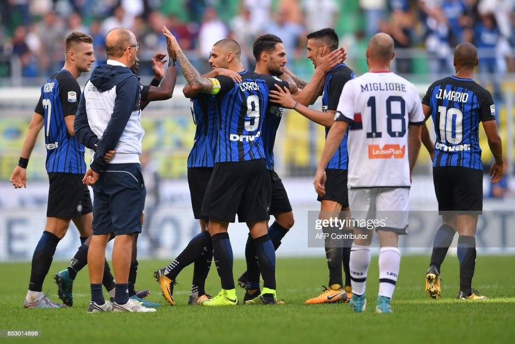 Inter Milan's Argentinian forward Mauro Emanuel Icardi (C) celebrates at the end of the Italian Serie A football match Inter Milan ss Genoa on September 24, 2017 at the San Siro stadium in Milan. /
