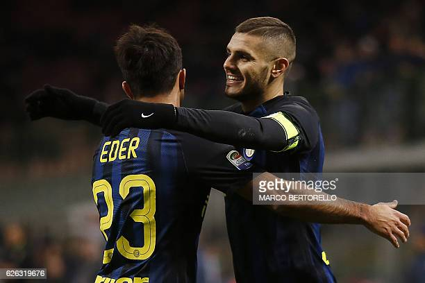 Inter Milan's Argentinian forward Mauro Emanuel Icardi celebrates with his teammates Italian forward Eder after scoring a goal during the Italian...