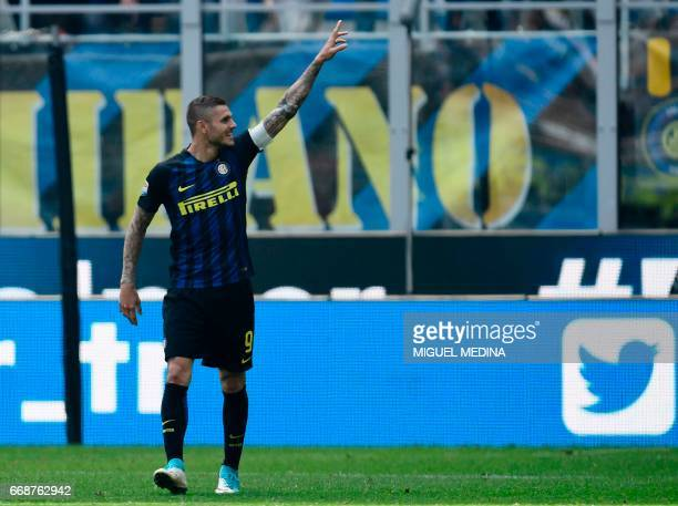 Inter Milan's Argentinian forward Mauro Icardi celebrates after scoring during the Italian Serie A football match Inter Milan vs AC Milan at the San...