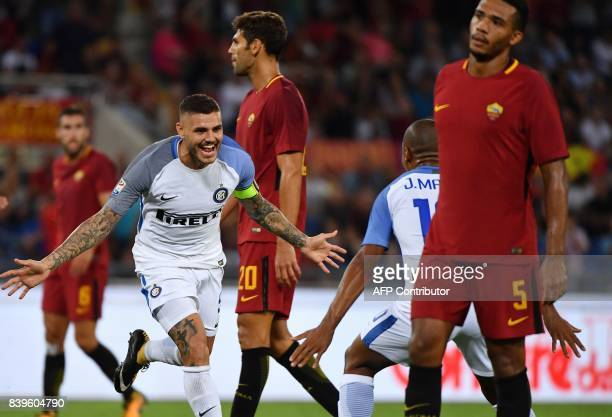 Inter Milan's Argentinian forward Mauro Icardi celebrates after scoring during the Italian Serie A football match Roma vs Inter Milan on August 26...