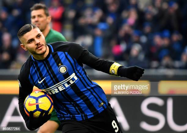 Inter Milan's Argentinian forward Mauro Icardi celebrates after scoring during the Italian Serie A football match Inter Milan vs Udinese on December...