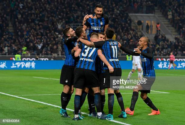 Inter Milan's Argentinian forward Mauro Icardi celebrates with teammates after scoring a goal during the Italian Serie A football match between Inter...