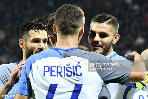 Inter Milan's Argentinian forward Mauro Icardi celebrates with teammates after scoring a goal during the Italian Serie A football match between...