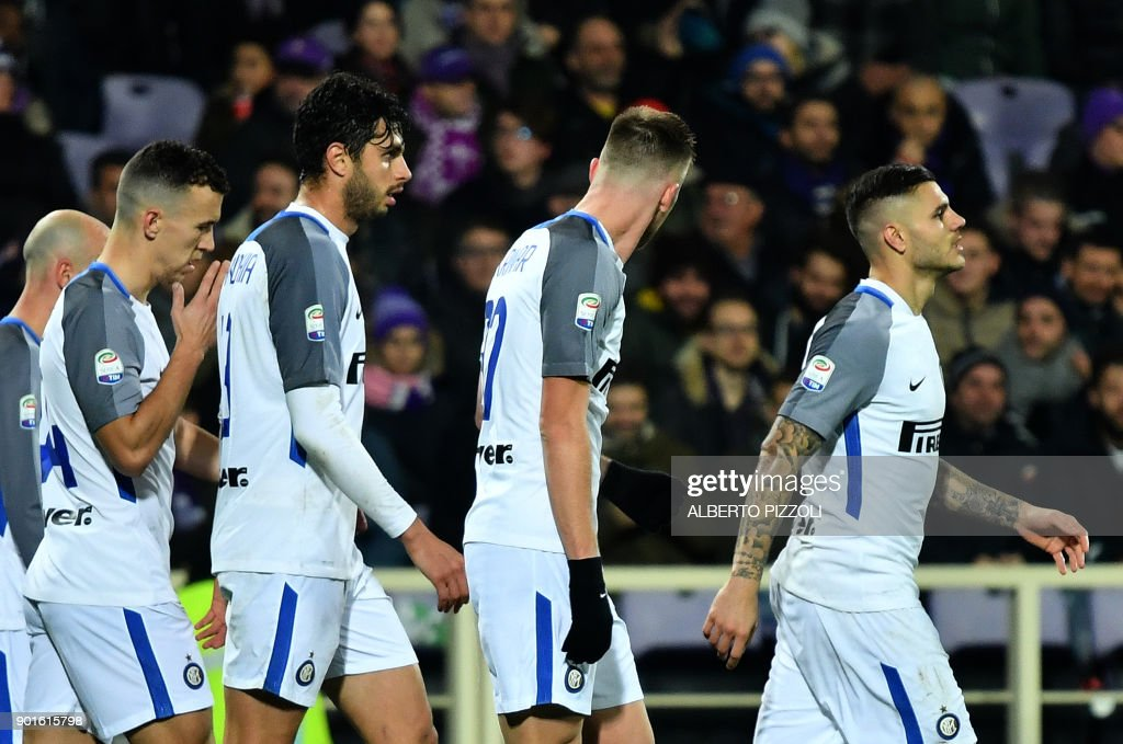 Inter Milan's Argentinian forward Mauro Icardi (R) celebrates with teammates after scoring during the Italian Serie A football match between Fiorentina and Inter Milan at The Artemio Franchi Stadium in Florence on January 5, 2018. /
