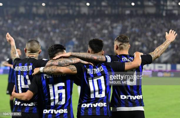 Inter Milan's Argentinian forward Mauro Icardi celebrates with Inter Milan's Belgian midfielder Radja Nainggolan Inter Milan's Italian midfielder...